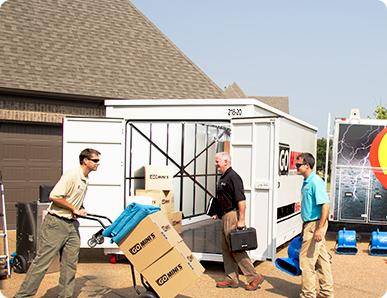 Guys unloading Go Mini's Container