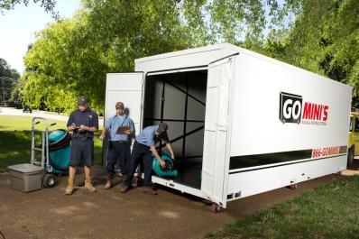 Team unloading Go Mini's unit