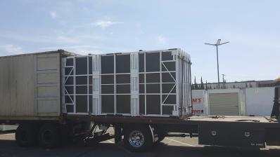 Unit being loaded on truck